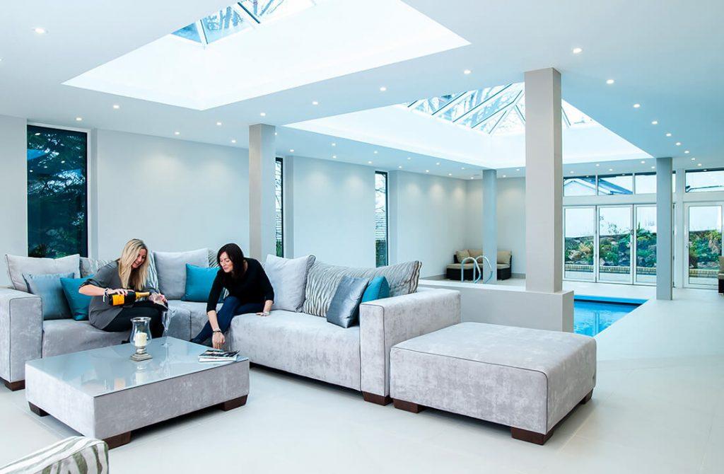 Women on couch under Lantern Roofs